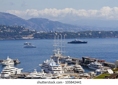 Panoramic view of Monte-Carlo harbor in Monaco. Principality of Monaco is a sovereign city state, located on the French Riviera in Western Europe.