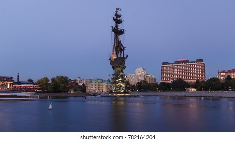 Panoramic view of the monument to Russian emperor Peter the Great, on background of blue sky. Timelapse hyperlapse from day to night transition, Moscow, Russia
