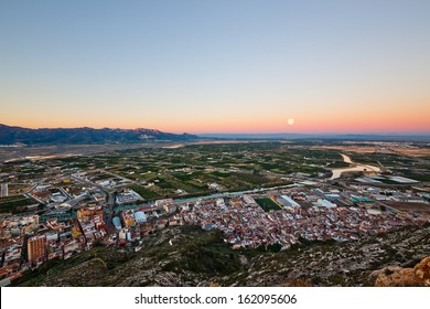 Panoramic view of moonrise on a small spanish city Cullera, near Valencia, Spain