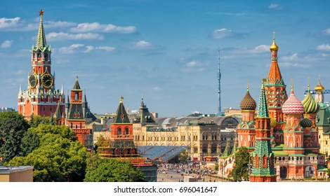 Panoramic view of Moscow Kremlin and St Basil`s Cathedral, Russia. Panorama of Red Square in summer. It is the main tourist attraction of Moscow. Beautiful St Basil`s Cathedral in the sunlight.