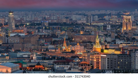 Panoramic view of Moscow - Kremlin towers, State general store, residential building at night