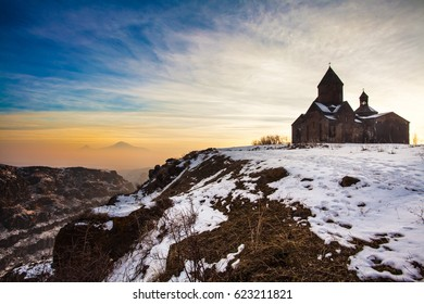 Panoramic view of Mount Ararat in Armenia with a beautiful medieval church in the foreground.. Sunrise over Ararat in Armenia.