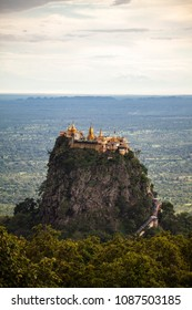 Panoramic view of Mount Popa Tajung Kalat temple rising in the distance in Myanmar