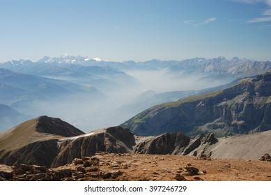 Panoramic view of mountain range and haze in Swiss alps