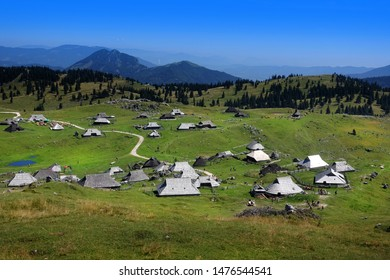 Panoramic view of mountain village in Alps, wooden houses in traditional style, Velika Planina, Slovenia, Europe