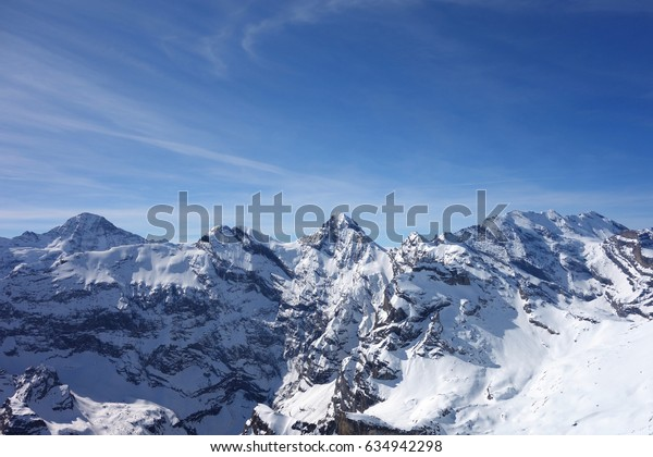 panoramic view of mountains covered with snow from top of Schithorn,Switzerland in early Spring