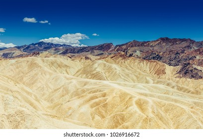 Panoramic view of mudstone and claystone badlands at Zabriskie Point. Death Valley National Park, California USA.