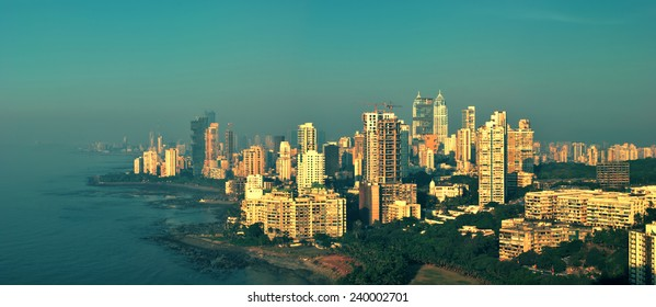Panoramic view of Mumbai's afluent Napean Sea area with Arabian sea at sunset in a warm glow. Here most of super rich billionaires and millionaires stay in high-rise towers. Copy space.