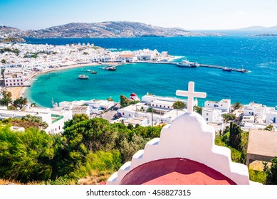 Panoramic view of the Mykonos town harbor from the above hills on a sunny summer day, Mykonos, Cyclades, Greece