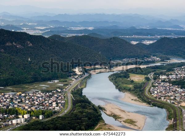 Panoramic view of Nagara river flowing through Gifu city from the top of Gifu castle on Mount Kinka