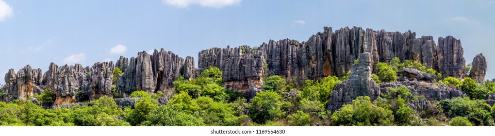 Panoramic view of Naigu Shilin limestone pinnacles Stone forest, Yunnan Province - China. The Stone Forest or Shilin is a UNESCO World Heritage Sites near Kunming