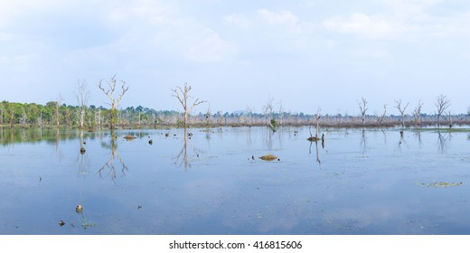 Panoramic view of Neak Pean lake, part of Khmer Angkor temple complex, popular among tourists ancient landmark and place of worship in Siem Reap, UNESCO site in Cambodia.