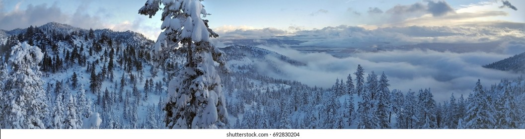 Panoramic view of near Lake Tahoe overlooking Nevada snow-covered valley.