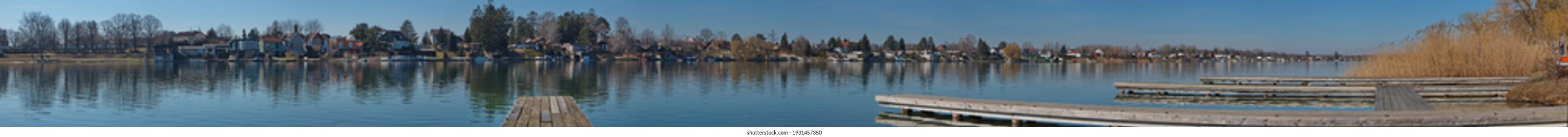 Panoramic view of Neufelder Lake in Neufeld an der Leitha, Burgenland, Austria, Europe  - Shutterstock ID 1931457350