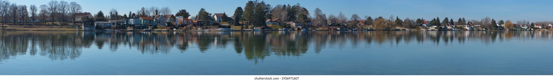 Panoramic view of Neufelder Lake in Neufeld an der Leitha, Burgenland, Austria, Europe  - Shutterstock ID 1936971607
