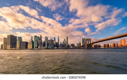 Panoramic view of New York City and its Brooklyn bridge at dusk, at Christmas