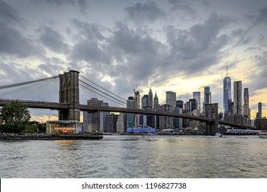 panoramic view new york city downtown manhattan skyline at evening with skyscrapers and brooklyn bridge