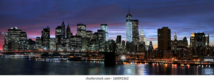 Panoramic view New York City Manhattan downtown skyline at night with skyscrapers