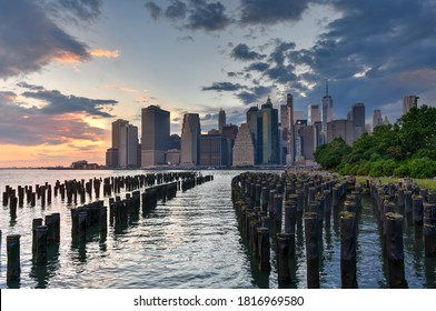 Panoramic view of the New York City skyline from Brooklyn Heights at sunset.