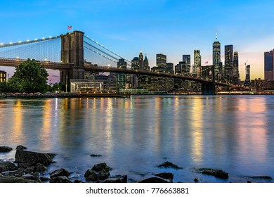 panoramic view new york city downtown manhattan skyline at night with skyscrapers and brooklyn bridge