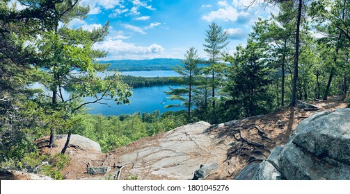 Panoramic view of newfound lake and follansbee cove near wellington state park beach from summit of Sugarloaf mountain near Bristol, New Hampshire (NH).