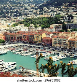 Panoramic view of Nice (Cote d'Azur, France) with harbor, yachts and beautiful buildings. View from above. Square toned image, instagram effect