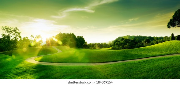panoramic view of nice green hill on blue sky background