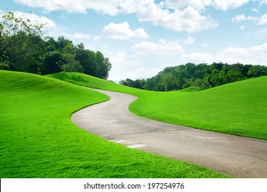 panoramic view of nice green hill and path  on blue sky background
