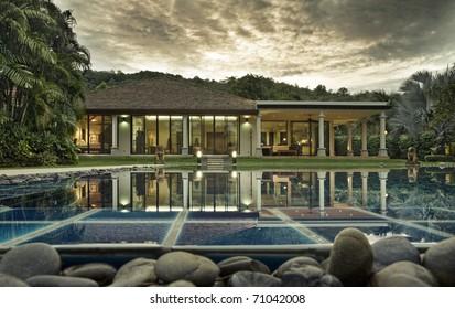 Panoramic view of nice tropic villa during sunset