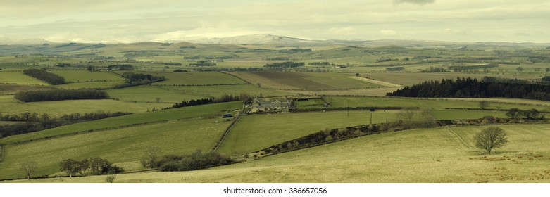 Panoramic view of Northumberland, looking north to the snow-covered Cheviot Hills. Photograph taken at the hills close to Edlingham, between Rothbury and Alnwick.