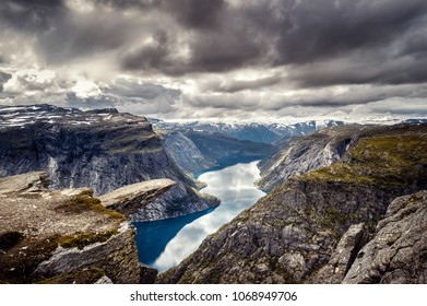 Panoramic view of norway landmark trolltunga, with fjord, lake and cloud sky. Tourism concept