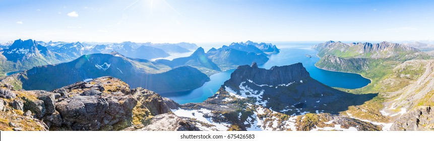 Panoramic view of a norwegian fjord in summer on Senja island in northern Norway, beautiful landscape
