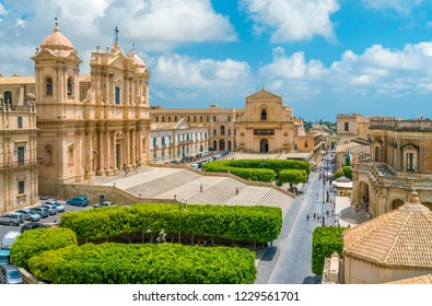 Panoramic view in Noto, with the Cathedral, Palazzo Ducezio and the Santissimo Salvatore Church. Province of Siracusa, Sicily, Italy.