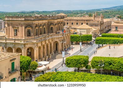 Panoramic view in Noto, with the Palazzo Ducezio and the Church of San Carlo. Province of Siracusa, Sicily, Italy.