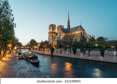 Panoramic view of Notre dame in Paris (Our Lady of Paris) at dusk. It is a medieval Catholic cathedral, considered to be one of the finest examples of French Gothic architecture.