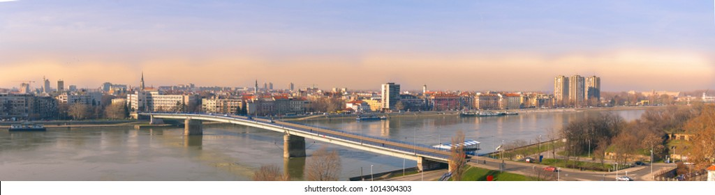 Panoramic view of Novi Sad, Serbia cityscape, Danube river and Petrovaradin fortress in the beautiful misty evening sundown