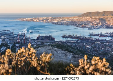 Panoramic view of Novorossiysk City and  Tsemess Bay at sunrise. Morning cityscape of large port at Black Sea coast in Russia