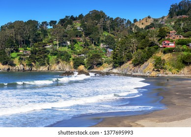 Panoramic view of ocean Wave breaking along Muir Beach with view of houses on the hill, California, San Francisco, USA