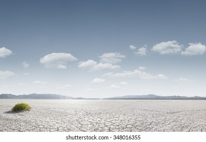 panoramic view od dry desert in death valley with some mountains on the back