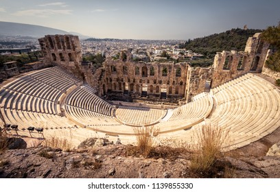 Panoramic view of the Odeon of Herodes Atticus at the Acropolis of Athens, Greece. It is one of the main landmarks of Athens. Scenic panorama of Herod Atticus Odeon overlooking Athens city in summer.