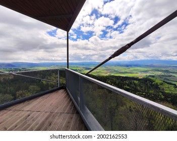 Panoramic view of, among others, the Karkonosze and the vicinity of Wałbrzych from a metal, high tourist observation tower in the Polish mountains, on the top of the Trójgarb in Wałbrzyskie Mountains - Shutterstock ID 2002162553