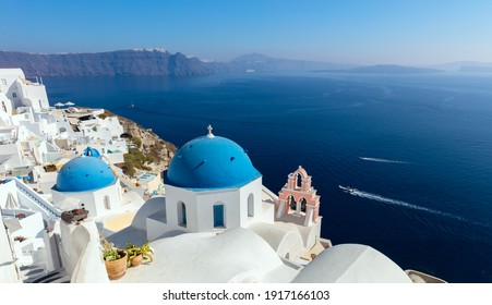Panoramic view of Oia town cityscape at Santorini island in Greece. Traditional white houses. Greece, Aegean sea. Famous European destination