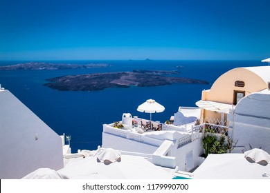 Panoramic view from Oia village on suny day , Santorini island, Greece.