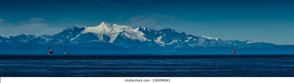 Panoramic view of oil platforms in Cook Inlet, Alaska with Mt. Spurr in behind