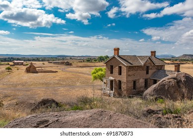 Panoramic view of old brick structure on military post in west Texas from up on the hill behind the structure