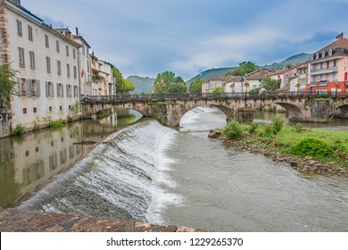 Panoramic view of the old bridge that crosses the river Salat and dams on its way through the village of Saint Girons. Ariege France