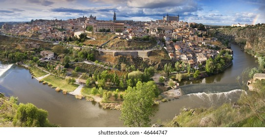 Panoramic view in the old city in Toledo with rainbow. Spain