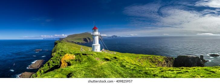 Panoramic view of Old lighthouse on the beautiful island Mykines, Faroe islands, Denmark