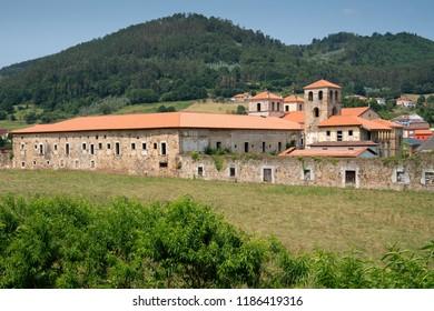 Panoramic view to the old monastery of Cornellana, landmark on the Camino de Santiago trail between Grado and Salas, Asturias, Spain