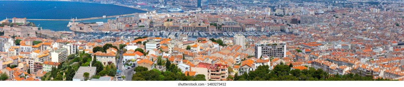 Panoramic view of the Old Port and the famous city embankment on a sunny day. Marseilles. France.